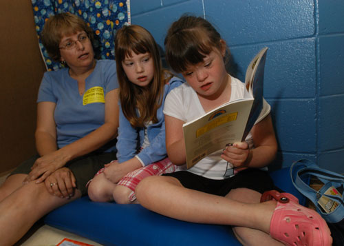 Students Reading with Teacher