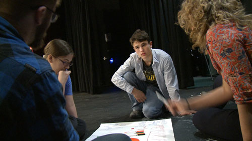 ConVal High School Film Still - Group Meeting on Stage