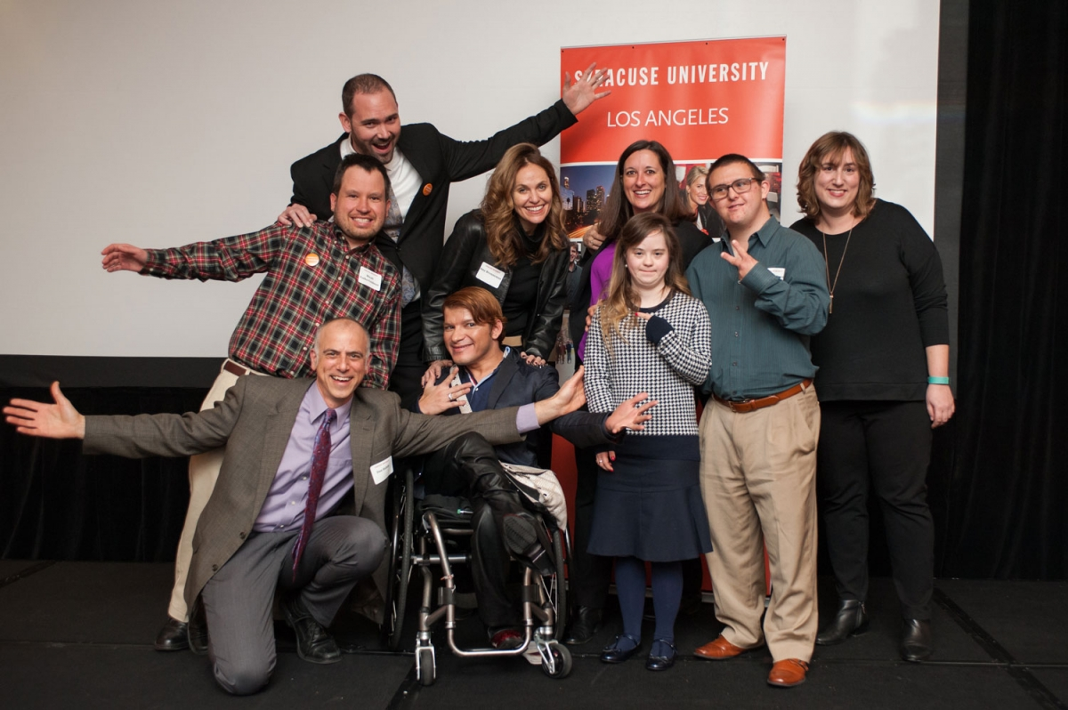 "The ""Redefining Inclusion"" panelists and guests pose for a group photo before the LA event. Dan Habib kneels next to Andy Arias, with (from left) Micah Fialka-Feldman, Brent Elder, Amy Brenneman, Beth Myers, Megan and Sean from A&E's Born This Way, and Carrie Rosen. Photo by Rich Prugh"