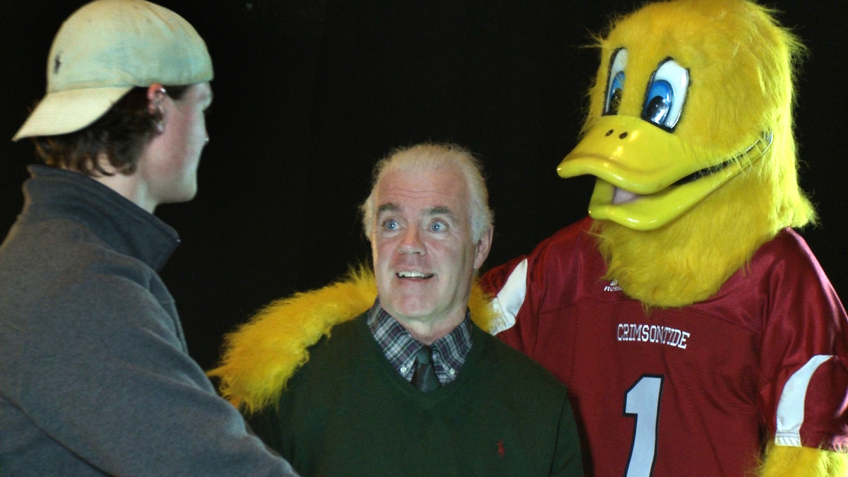 Principal Connolly with mascot and student